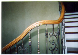 iron balusters with red oak handrail