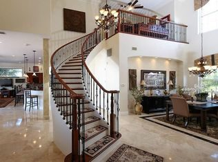 Designed and built by Creative Custom Stairs, this curved staircase was built in Port Charlotte, FL using black cherry treads and painted risers. The Old World black cherry handrail and Old World satin black balusters create remarkable lines. The elegant starting step is a double bullnose black cherry tread.