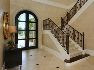 Located in Bradenton, this beautifully engineered u-shaped staircase has a Romanesque feel. With its large circular medallions amongst the oval shaped balusters. The bullnose stained starter tread creates a nice contrast to the light colored carpeted tread and risers.